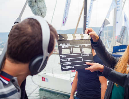 s video: TRIESTE, ITALY - OCTOBER 12: Girl holding clapperboard During the production of short films on October 12, 2014