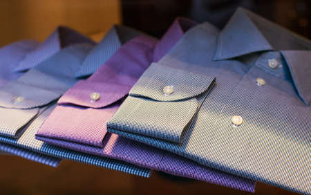 formal clothing: Close up of male shirts exposed in the clothes shop Stock Photo