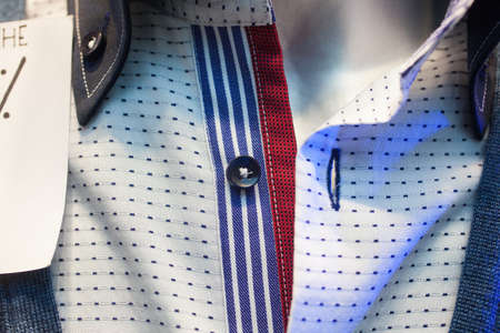 buttonhole: Close up of male shirts exposed in the clothes shop Stock Photo