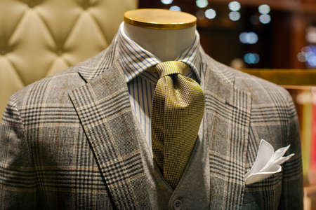 man in suit: Close up of male suit exposed in the clothes shop