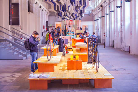 to designate: MILAN ITALY APRIL 16: People visit at Tortona Fuorisalone space location of important events during Milan Design Week on April 16 2015