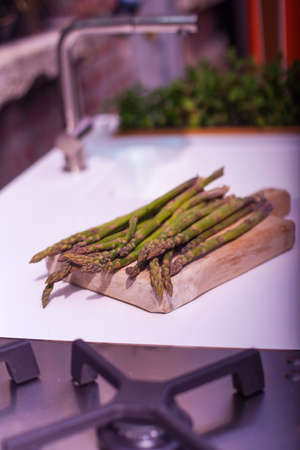 diuretic: View of bunch of fresh asparagus on cutting board