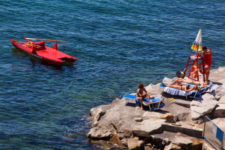 seaboard: TRIESTE, ITALY - MAY, 10: People tanning in the Trieste seaboard on May 10, 2015