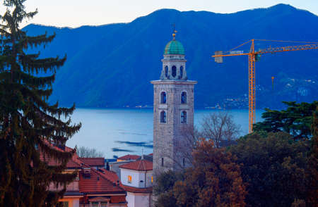 lawrence: The bell tower of the St. Lawrence cathedral of Lugano taken near the train station. Stock Photo
