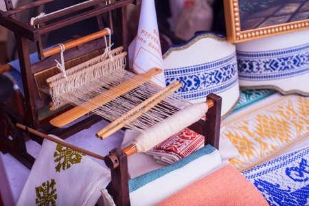 loom: View of loom white thread homemade Stock Photo