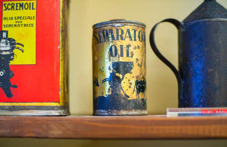 cruet: View of old lubricant bottles on the shelf