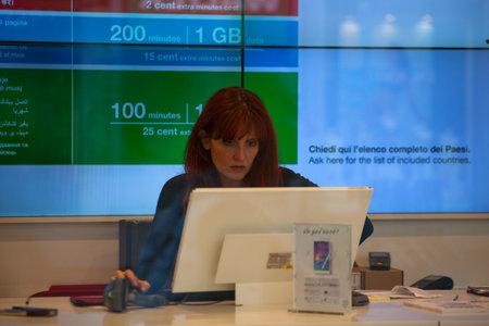 employed: MILAN, ITALY - JUN, 21: Woman employed working behind his computer on Jun 21, 2015