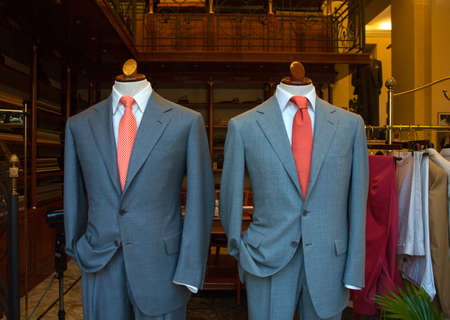 suit  cuff: Business male suits on shop mannequins high fashion retail display Stock Photo