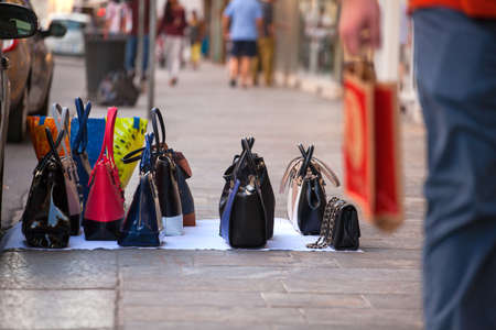 Counterfeit italian bags for sales in the street Imagens - 44519234