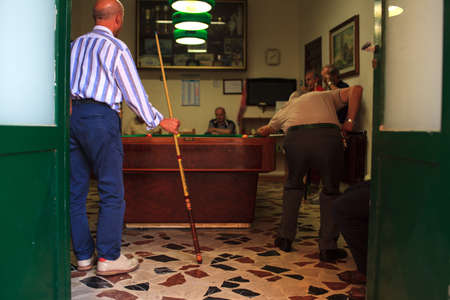 pool hall: ERICE, ITALY - AUGUST 05: Group of young friends playing billiard on August 05, 2015 Editorial