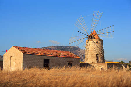 trapani: View of windmill in the salt pans, Trapani. Sicily
