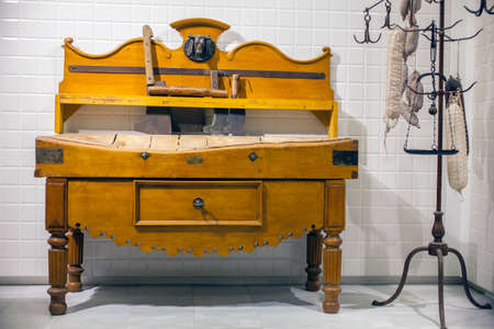 forniture: MILAN, ITALY - SEPTEMBER, 13: Old forniture for butchery end of XIX Century courtsey Steno Tonelli, exposed in the Triennale pavilion of Expo during the Arts & Foods exibition curated by Germano Celant on September 13, 2015 Editorial