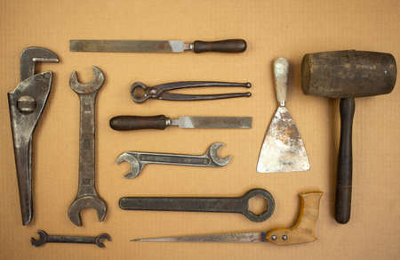 putty knives: View of old set tools. Hammer, putty, knife, pliers, saw, file, wrench Stock Photo