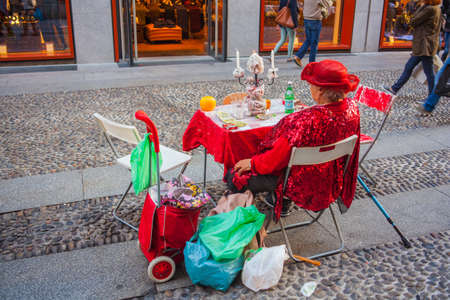 telepathy cards: MILAN, ITALY - OCTOBER, 11: Fortune teller waiting clients in the street on October 11, 2015