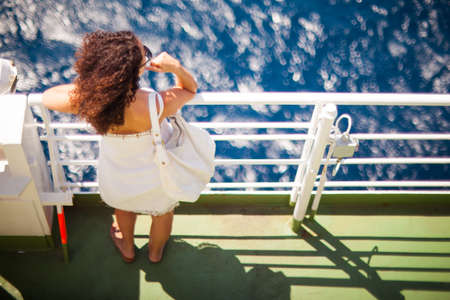 ferryboat: MESSINA, ITALY - AUGUST, 26: Girl looking the sea from ferry-boat on August 26, 2015
