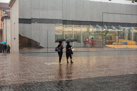 in september: MILAN, ITALY - SEPTEMBER, 13: Women under the rain on September 13, 2015 Editorial
