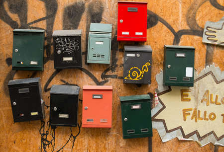 wooden post: Italian post boxes on wooden wall