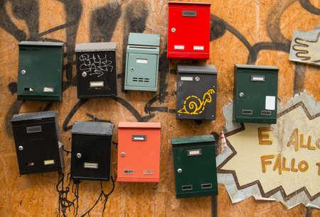await: Italian post boxes on wooden wall