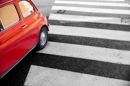 pedestrian crossing: View of Cinquecento, retro Italian car on pedestrian crossing