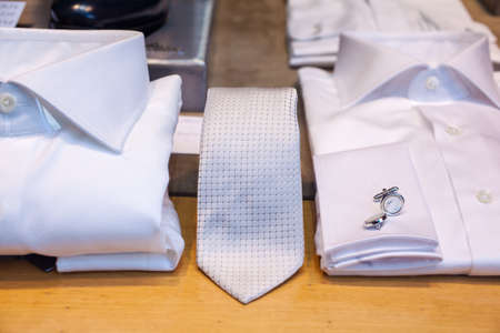 cuff: White male shirts with cuff link and necktie Stock Photo