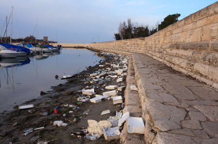december 31: CHIOGGIA, ITALY - DECEMBER, 31: View of domestic garbage next to the sea on December 31, 2015