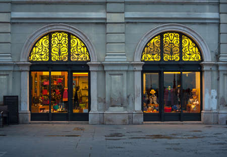 window view: View of illuminated shop window in Trieste Editorial