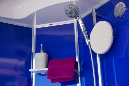 towel head: View of towel liquid soap and shower head Stock Photo