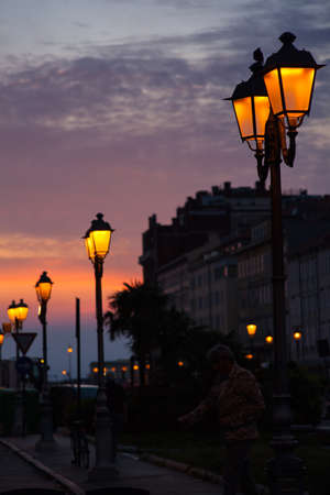 trieste: View of street lantern illuminated in Trieste, Italy