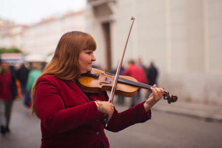 TRIESTE, ITALY - MAY, 14: Female violinist playing in the street on May 14, 2016 Editorial