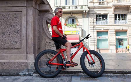 cycler: MILAN, ITALY - JUNE, 04: Biker in red waiting in the street on June 04, 2016 Editorial