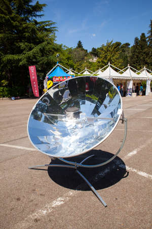 parabolic mirror: View of a parabolic dish solar energy mirror Stock Photo