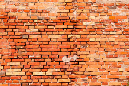 worn: Red old worn brick wall texture background Stock Photo
