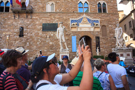 signoria square: FLORENCE, ITALY - JULY, 12: Tourists in the Signoria square on July 12, 2016 Editorial