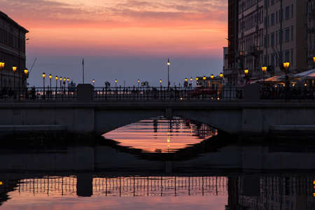 View of Ponte rosso in Trieste at sunset, Italy Editorial