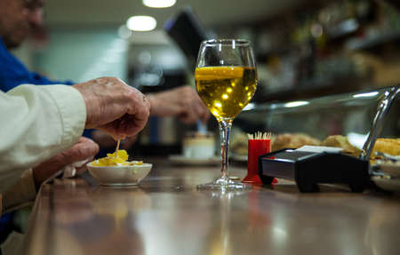 barkeep: Glass of beer and appetizer called tapas in a Santander bar