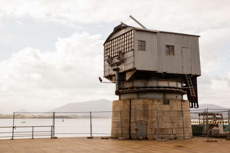 View of the old crane called Grua de Piedra on the seafront in Santander