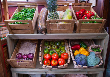 Vegetables and fruits on the wooden box in the street market