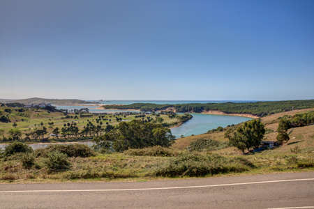pas: River Pas mouth, Liencres dunes nature reserve in the Cantabrian sea Stock Photo