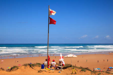 LIENCRES DUNES, SPAIN - AUGUST, 21: Lifeguards sitting on surveillance post in front of the sea on August 21, 2016 Editorial
