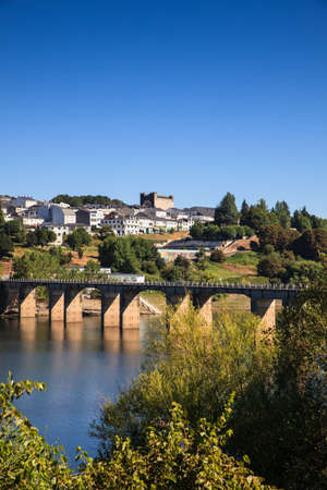 way of st james: Roman bridge over the Minho River in Portomarin, Spain