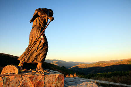 bronze statue of a pilgrim facing towards Santiago, Alto de San Roque, Spain