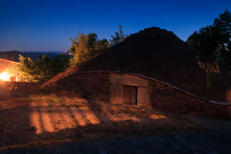 nightview: Nightview of the palloza, also known as pallouza or pallaza, is a traditional dwelling of Cebreiro and also the Serra dos Ancares of northwest Spain Stock Photo