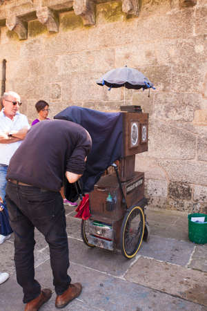 itinerant: SANTIAGO, SPAIN - AUGUST, 17: Ambulant photographer in action in the Santiago square on August 17 2016 Editorial