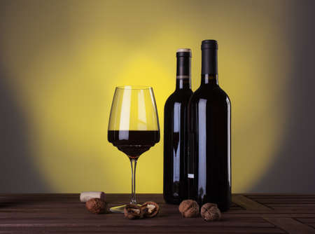 Italian red wine in bottles and wineglass