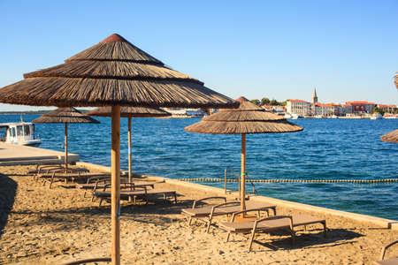Beach Umbrellas in Saint Nicholas Island in Porec, Istria. croatia