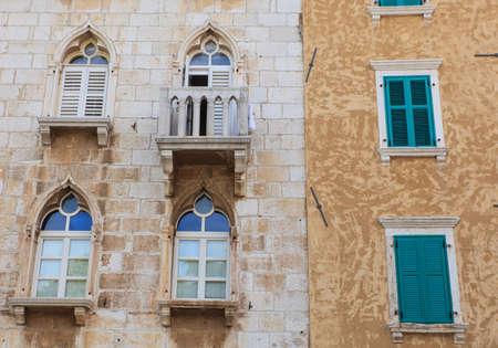 Old venetian windows in Porec, Istria. Croatia