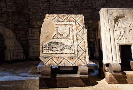 episcopal: Floor mosaic fragment with an image of a fish in the Euphrasian Basilica. Porec Stock Photo