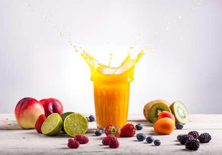 Nectarine juice splash. Various fruits on white table Stock Photo