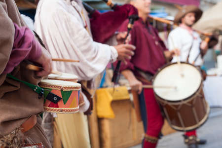 Historical drummers dressed in ancient clothes during the historical Reenactment