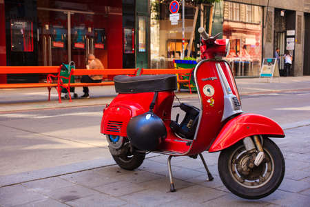 VIENNA, AUSTRIA - MAY, 22: Old red Italian scooter called Vespa manufactured by Piaggio parked in the Vienna street on May 22, 2018